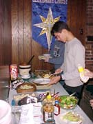 Jason selecting from potluck