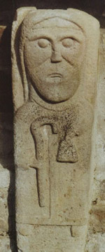 stone carving of a monk of the egyptian desert