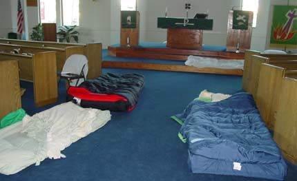 volunteers sleep on the floor of Bethel Lutheran's sanctuary (except on Sunday)