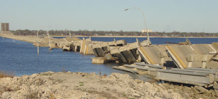 The bridge from Biloxi east on US 90 remains in ruins