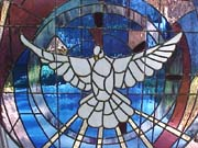 The stained glass window of Genesis 1:1 at King of Peace