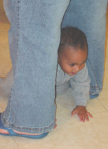 Colby crawling under his Mama's legs in the entry hall
