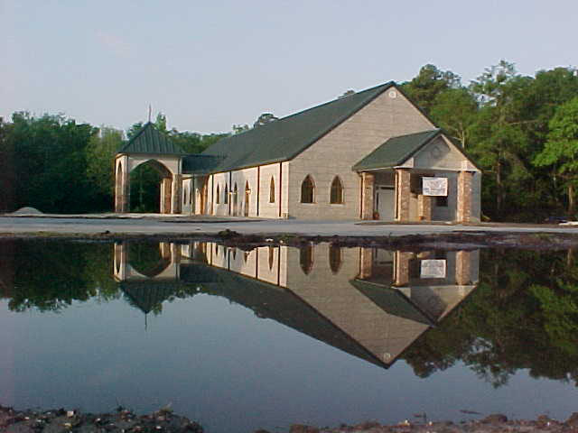 Our church as construction was ending and a large mud puddle looked lake like out front