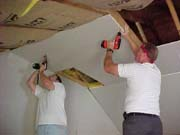 Mark and Robert putting up drywall