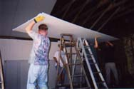 Lifting a 144-pound piece of sheetrock to the ceiling