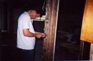 John Helberg works on the electrical lines