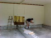Tom Campbell removes paneling in the garage