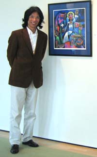 He Qi with one of his paintings