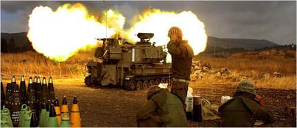 An Israeli tank fires into Lebanon from Kryat Shmoneh