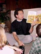 Father Frank reads a story about the Creation