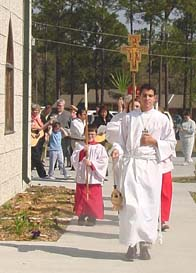 Jason White leads the traditional Plam Sunday procession