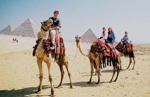 Frank with his wife, daughter and mother-in-law on camels at the Great Pyramids in Egypt