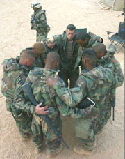 soldiers in prayer