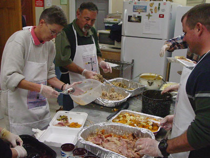 Serviong the Thanksgiving meal for the community