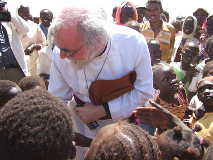 Rowan Williams with children in the Sudan