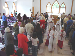 the congregation standing for the closing hymn