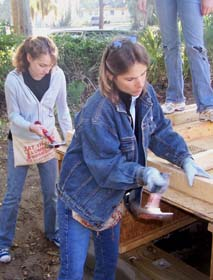 Griffin and Celeste working on a Habitat for Humanity house